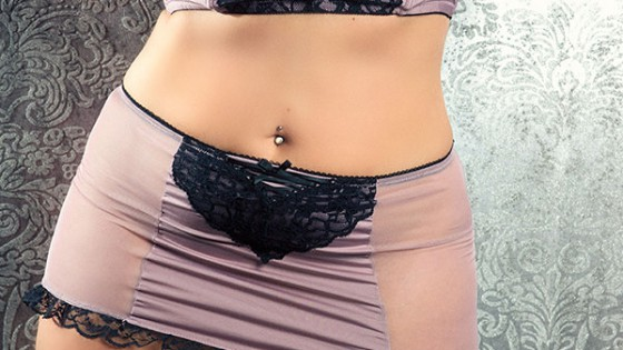 Nashville sensual massage artist in satin purple lingerie.