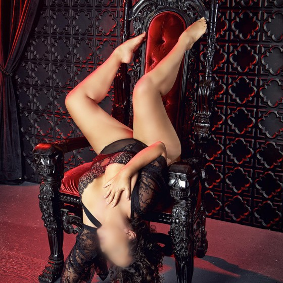 Sensual massage Nashvile artist Ava Ananda relaxing in sexy black lingerie.